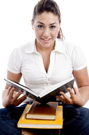 young woman going to read book with white background photo