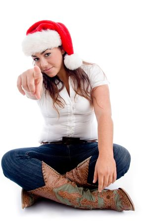 pointing woman with christmas hat against white background photo