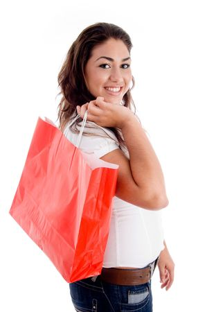woman holding bag: side pose of woman holding bag on an isolated background