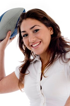 smiling woman with rugby ball against white background photo