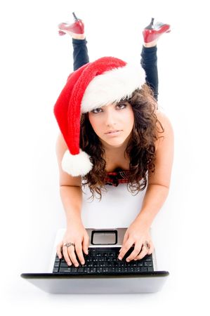 woman wearing christmas hat and working on laptop on an isolated white background photo