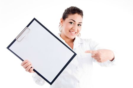portrait of doctor pointing notepad on an isolated background photo