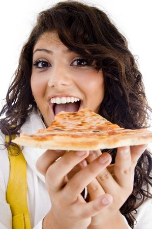 pretty woman eating delicious pizza against white background