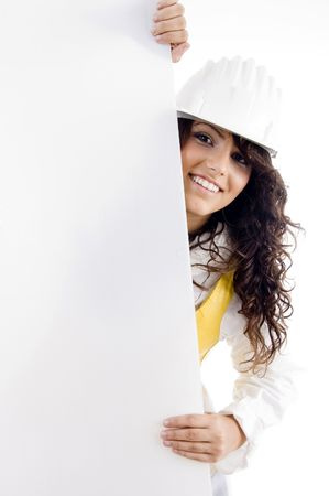 female architect: professional female architect peeping over placard on an isolated white background