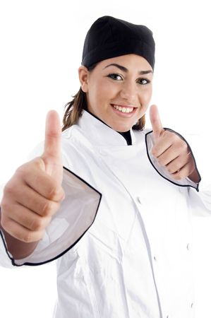 successful female chef showing thumbs up on an isolated white background photo