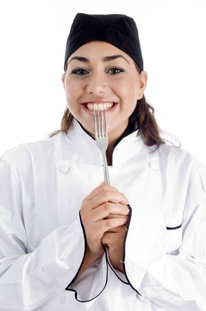 smiling female chef showing fork on an isolated background Stock Photo - 3934045