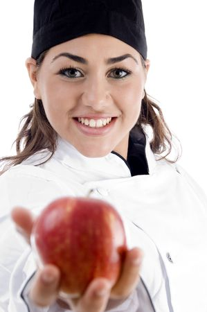 professional female chef showing fresh apple on an isolated white background