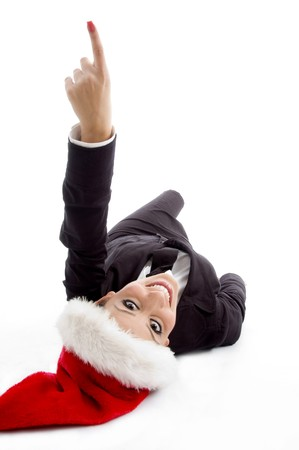 executive with christmas hat pointing upward on an isolated background photo