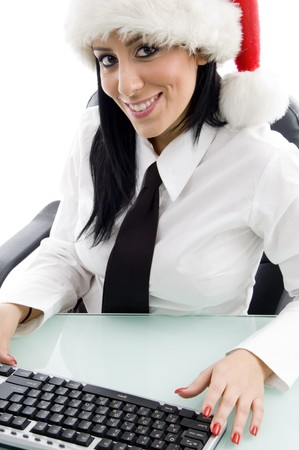 christmas woman with keyboard against white background photo