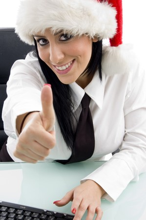 woman with christmas hat and thumbs up on an isolated white background photo