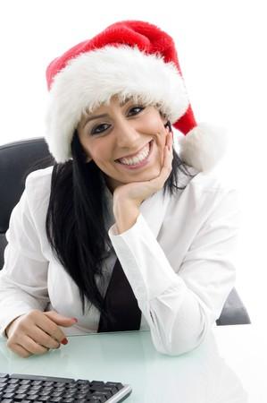 female wearing christmas hat against white background photo