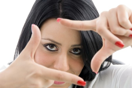 woman showing frame hand gesture on an isolated white background photo