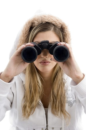 professional photographer eyeing with binoculars on an isolated white background photo
