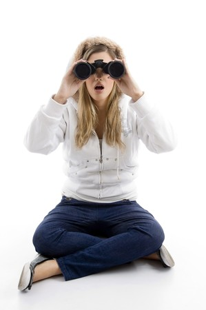 young female watching into binoculars against white background photo