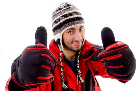 young man in woolen cap and jacket with thumbs up against white background Stock Photo - 3951119