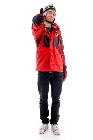 21: handsome young caucasian in winter clothes with thumbs up  with white background