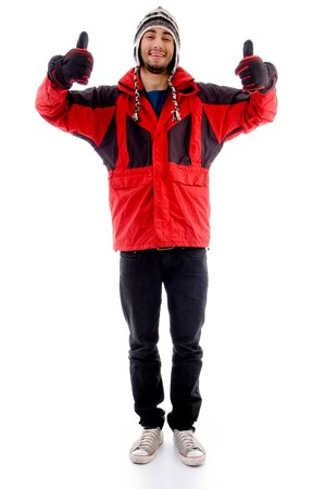 man wearing winter cap and jacket showing thumbs up against white background Stock Photo - 3950763