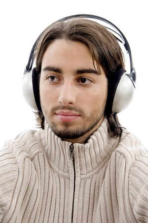 young guy male enjoying music with headphones on an isolated white background photo