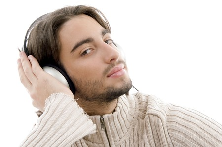 young guy male enjoying music with headphones on an isolated white background Stock Photo - 3975043