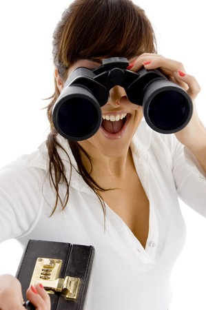 front view of excited female attorney viewing through a pair of binoculars against white background Stock Photo