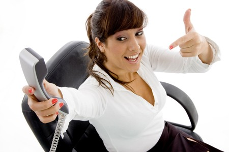 high angle view of businesswoman pointing at phone against white background photo
