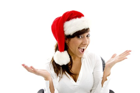 front view of happy female executive wearing christmas hat on an isolated white background photo