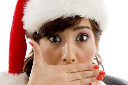 front view of shocked female attorney wearing christmas hat against white background photo