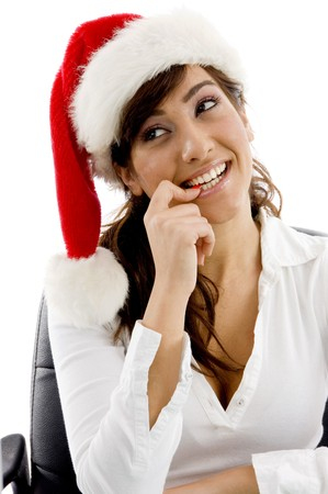 front view of shy female executive wearing christmas hat looking sideways on an isolated white background photo