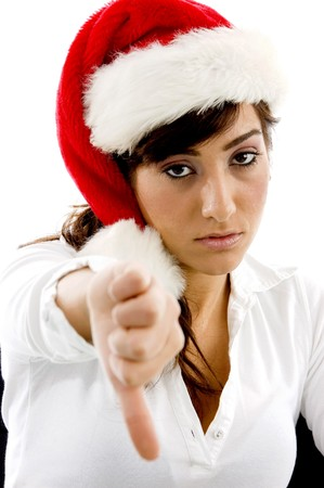 front view of disappointed businesswoman in christmas hat with thumbs down against white background photo