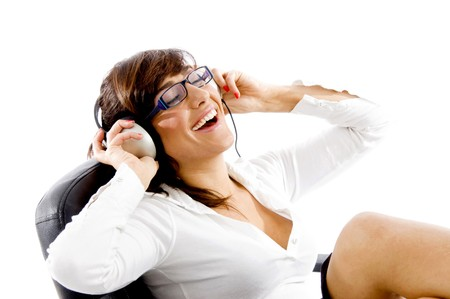 side view of smiling woman listening to music with white background photo
