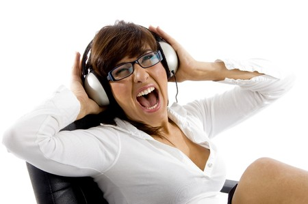 side angle view of businesswoman passionate for music against white background photo