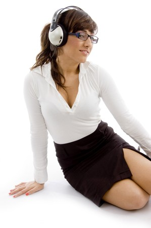 front view of female accountant listening music with headphones   against white background photo