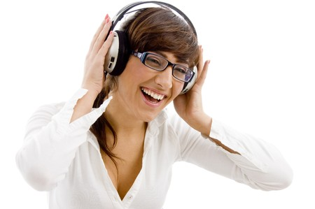 front view of smiling female listening music with headphone  on an isolated white background photo