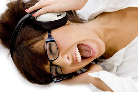 high angle view of woman enjoying music with white background photo