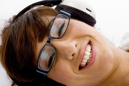 close up of smiling woman listening to music on an isolated background photo