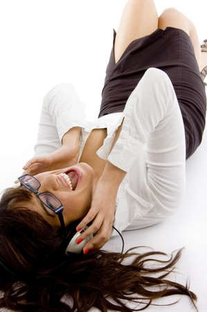 high angle view of happy woman enjoying music with white background photo