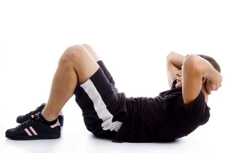 crunches: man doing crunches with white background
