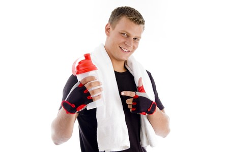 smiling muscular man pointing at the water bottle with white background Stock Photo - 3950549