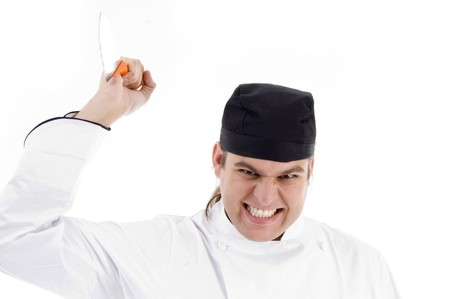 male chef attacking with knife with white background photo