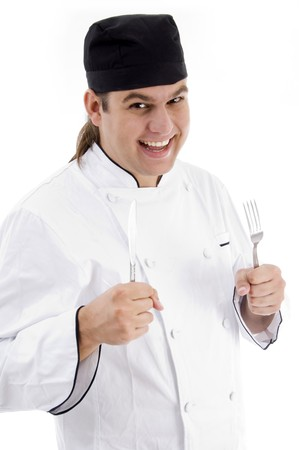 portrait of young chef smiling on an isolated white background photo