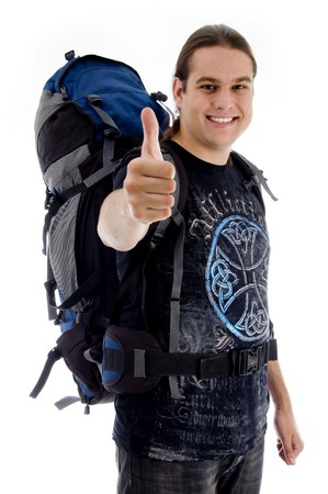 traveler with rucksack and thumbs up on an isolated white background