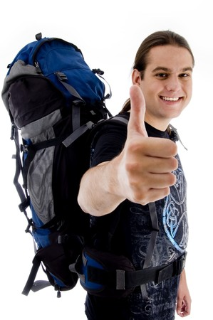 pointing traveler with bag on an isolated white background photo