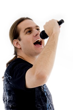 young male singing into microphone on an isolated white background Stock Photo - 3950993