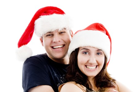 portrait of pleased couple with christmas hat on an isolated white background photo