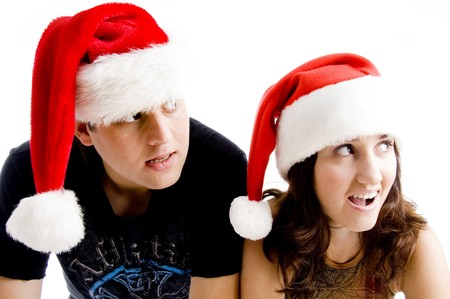 portrait of young couple wearing christmas hat with white background photo