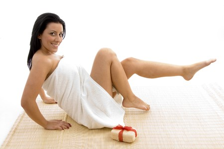 scrubber: front view of smiling woman in towel posing with scrubber on white background Stock Photo