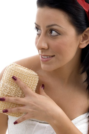 scrubber: close view of young woman opening the ribbon of scrubber on an isolated background Stock Photo