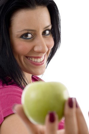 side pose: lado plantean el placer de las mujeres j�venes que ofrece Apple en un aislado fondo Foto de archivo