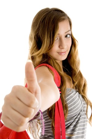 goodluck: young woman showing goodluck sign on an isolated background