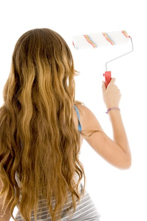 back pose of girl with paint brush on an isolated background Stock Photo - 3972674
